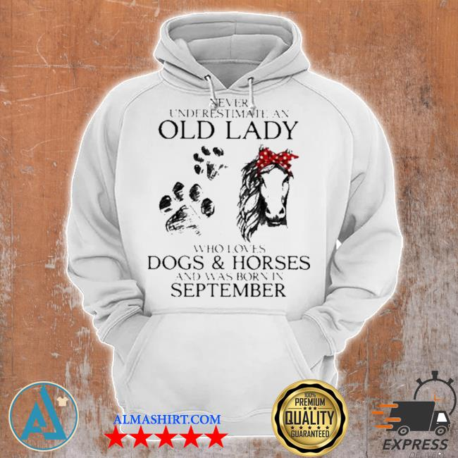 Never underestimate an old lady who loves dogs and horses and was born in september s Unisex Hoodie